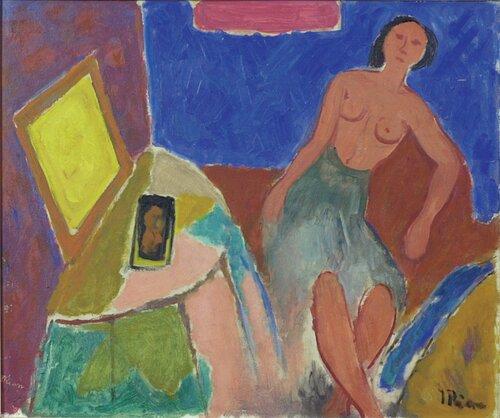 Kvinne ved toilettbord