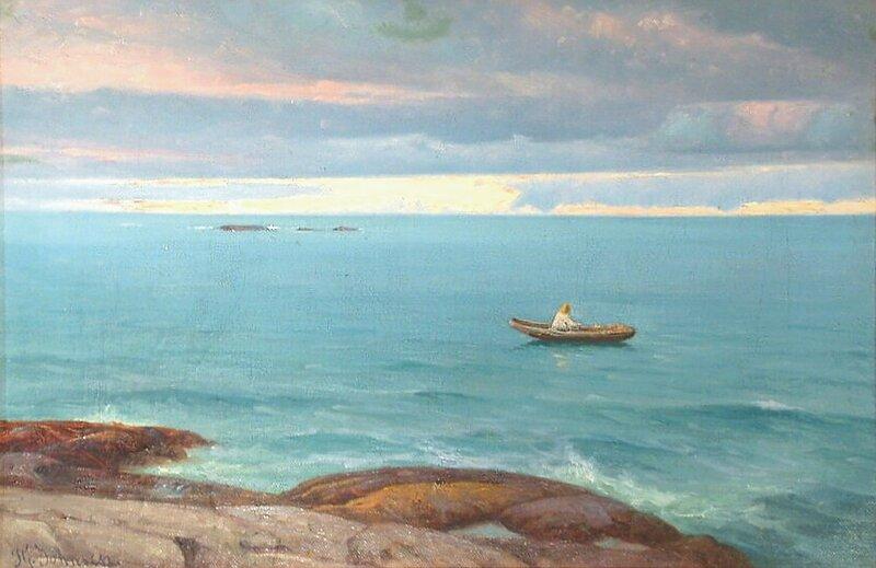 Mann i pram ved havet