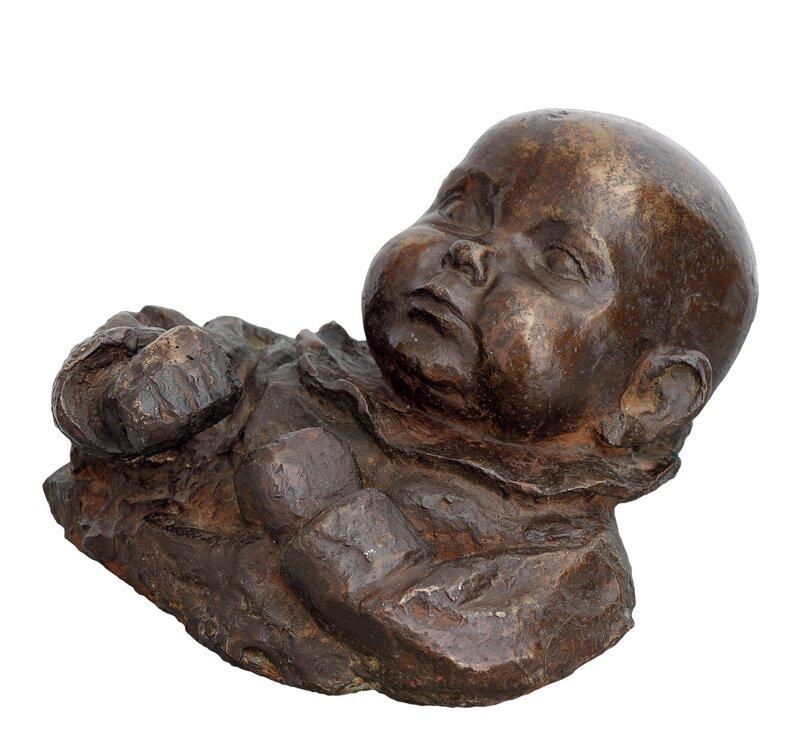 Byste av liggende baby