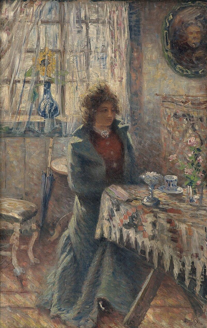 Sittende kvinne i interiør