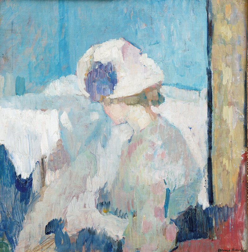 Kvinne ved bord 1909