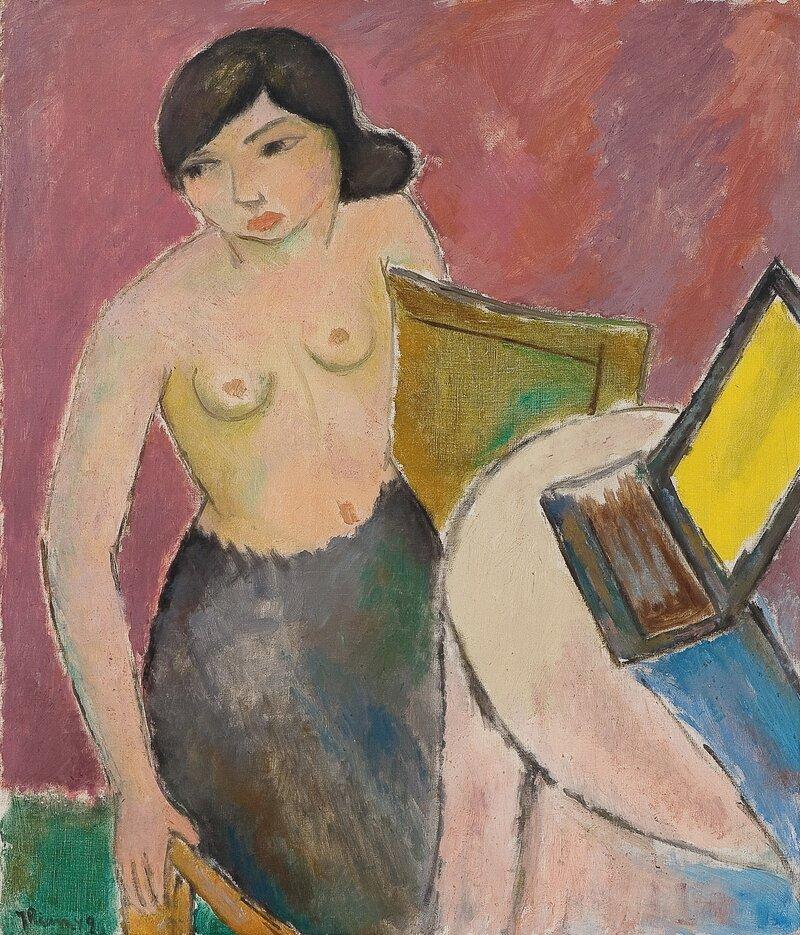 Kvinne ved toalettbord 1949