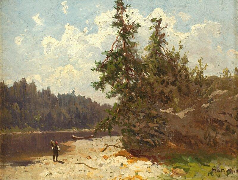 Mann i skoglandskap med vann