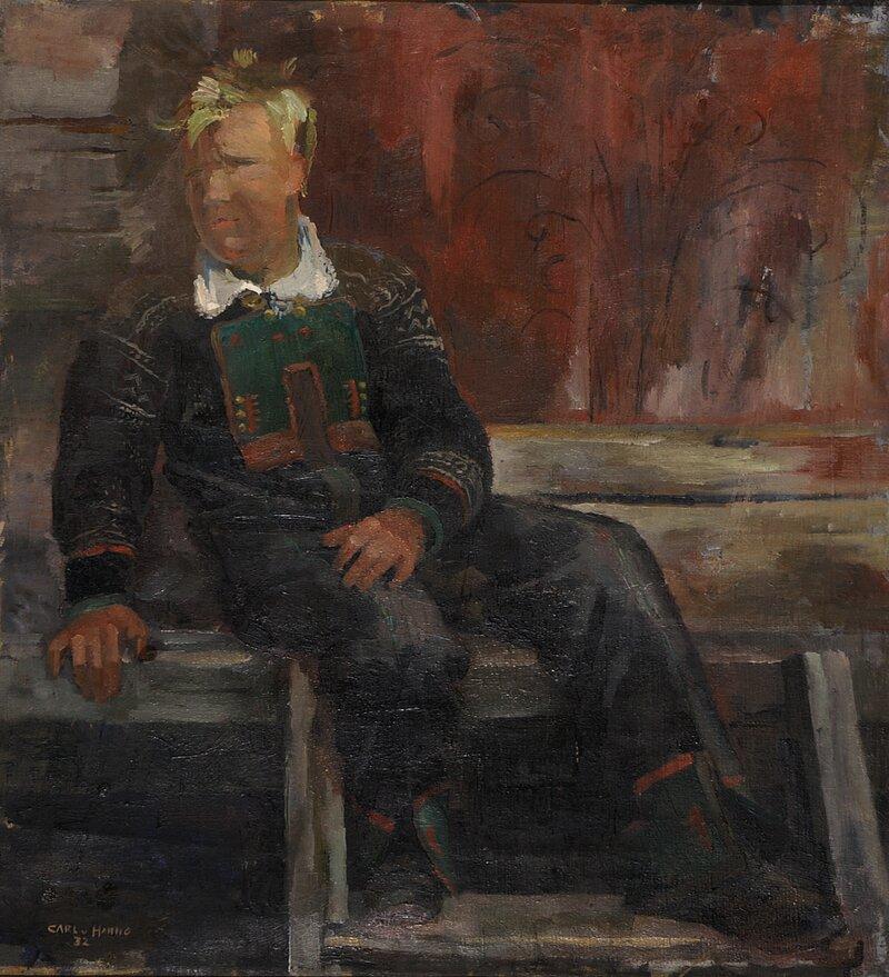 Sittende gutt i Setesdalsbunad 1932