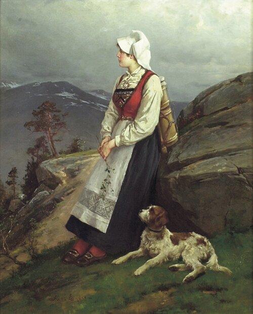 Ung bunadkledd kone med hund