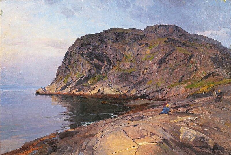 Maler ved staffeli i kystlandskap