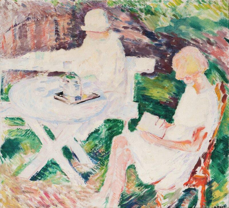 To kvinner sittende i en hage